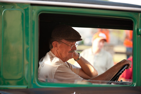 The driver of one of the vintage trucks in the parade.