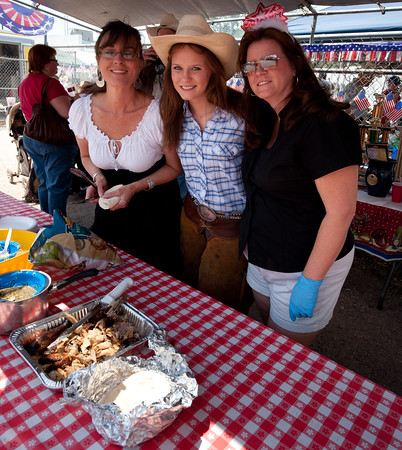 Members of one of the barbecue teams offering samples of their cooking.